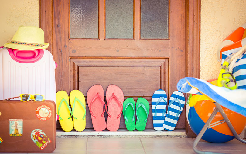 different colored sandles propped against door | EveryDry Toledo