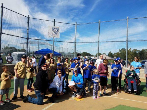EverDry Toledo Team and Miracle League of Northwest Ohio on baseball diamond.