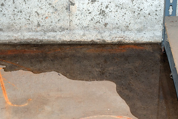 A basement without adequate waterproofing taking on water through cracks
